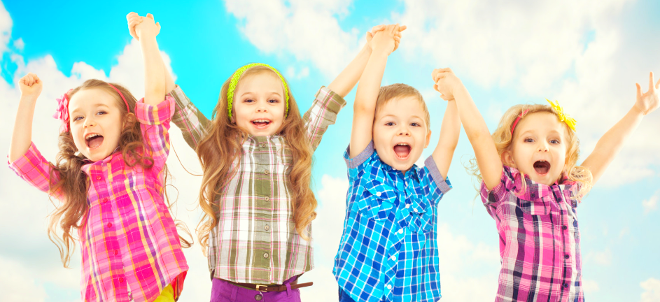 group of children are happy and raising their hands